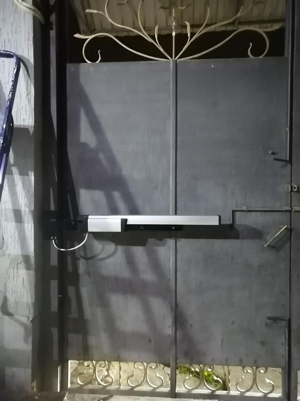 Секционные ворота Somfy Alutech Roger 2
